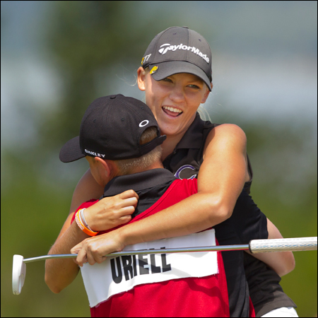 Alana Uriell is hugged by her caddie Austin Bordeaux during the quarterfinal round of match play